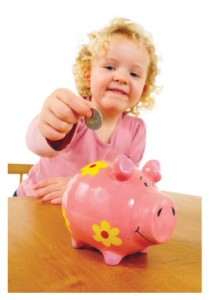 Girl placing money in a piggy bank